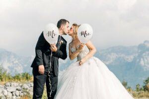 man and woman taking wedding photos